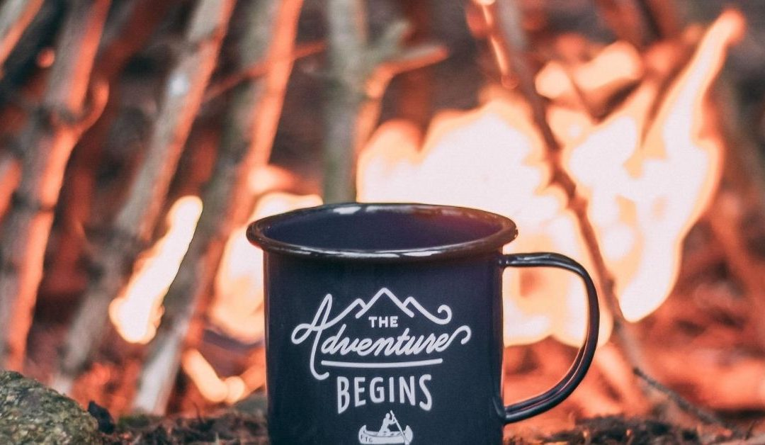 coffee mug with the adventure begins to denote making a marketing roadmap