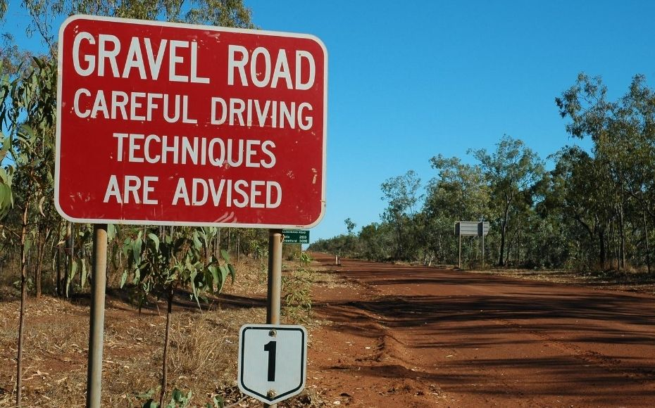 road sign with gravel road warning to denote making a marketing roadmap