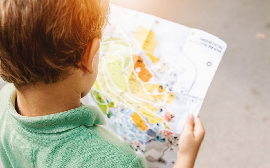 young boy reading a map denoting making a marketing roadmap