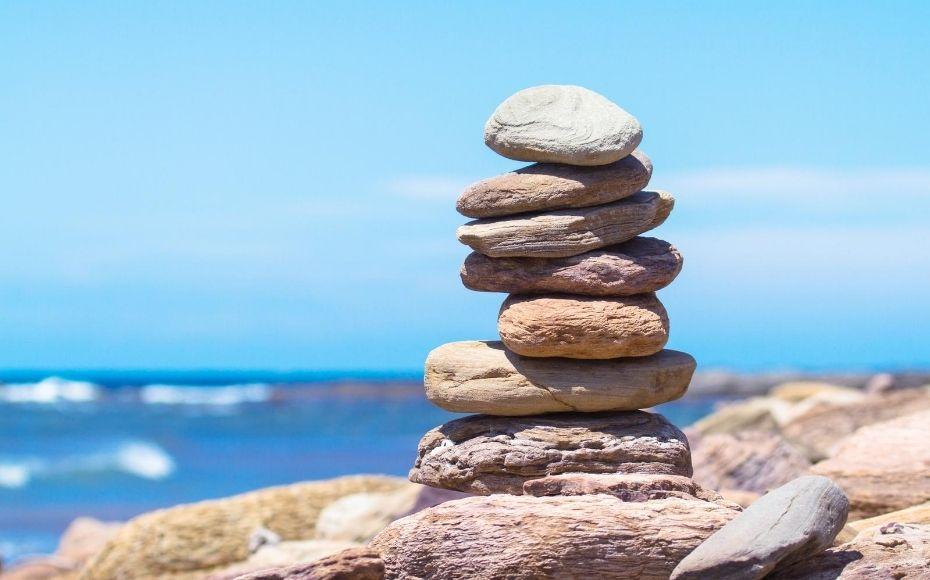rock cairns on a beach denoting making a marketing roadmap