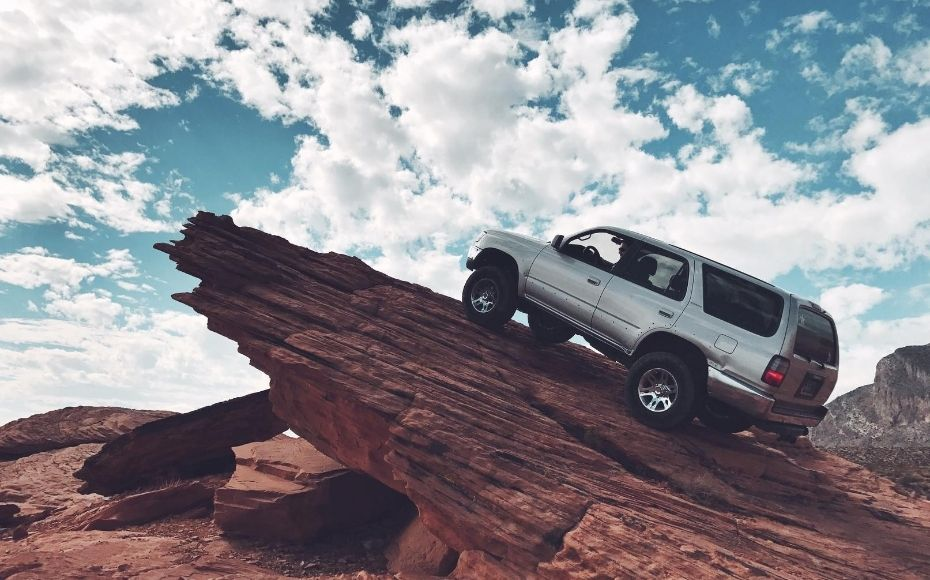 vehicle on 90 degree angle on rockface denoting making a marketing roadmap